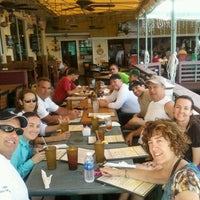 Photo taken at Pilot House Marina & Restaurant by David H. on 7/21/2012