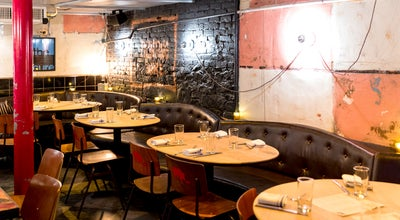 Photo of American Restaurant Swine at 531 Hudson St, New York City, NY 10014, United States