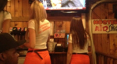 Photo of American Restaurant Hooters at 211 W 56th St, New York, NY 10019