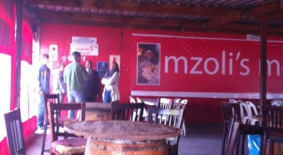 Photo of African Restaurant Mzoli's Meat Place at 1-3 Ny115, Cape Town 7750, South Africa