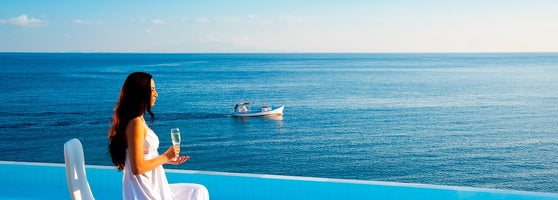 A Gl Of Champagne The View Aegean Sea And Warmth Late Afternoon Sun Your Experience At Petasos Beach Resort Spa Will Stay With You