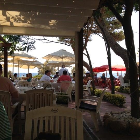 Photo taken at Canyelles Beach by Naira on 7/20/2012