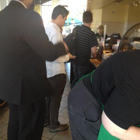 Photo taken at Starbucks by Mariela M. on 3/2/2012