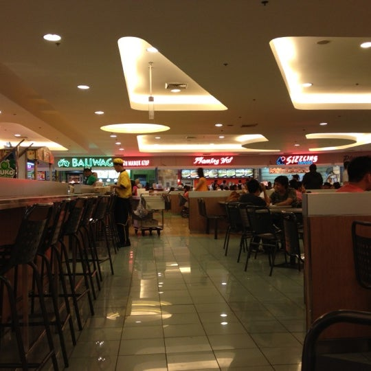 Photo taken at SM Food Court by Raffy T. on 3/24/2012