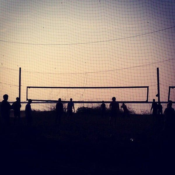 Photo taken at Whiskey Island Volleyball Courts by Luis C. on 5/22/2012