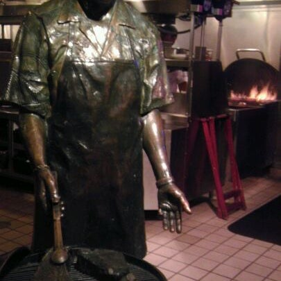 Photo taken at Weber Grill Restaurant by Ryan S. on 3/25/2012