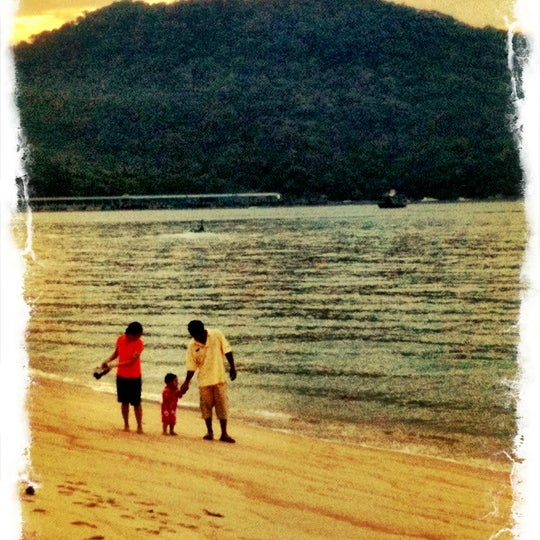 Photo taken at Teluk Bahang Beach by Dave R. on 2/26/2012