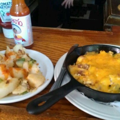 Photo taken at East Village Tavern by Mina V. on 5/19/2012