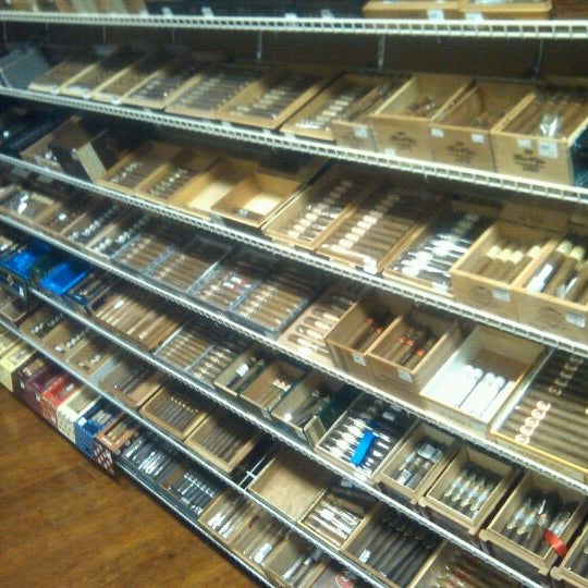 Photo taken at Smoky's Tobacco and Cigars by Tim Hobart M. on 10/28/2011