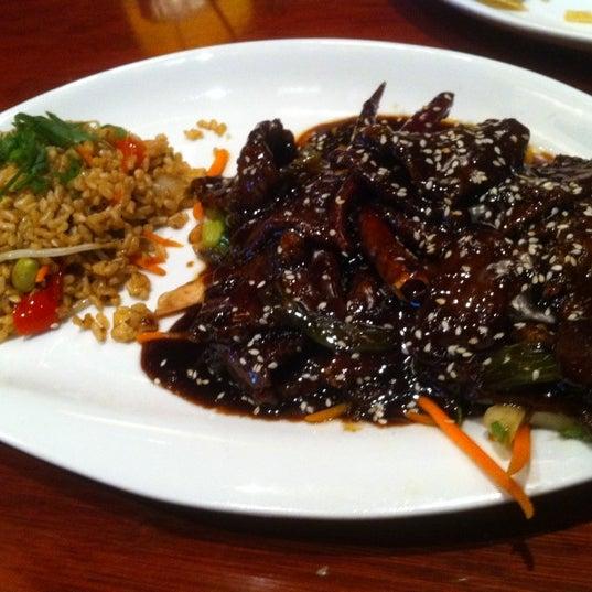 Photo taken at Elephant Bar Restaurant by Kelly C. on 9/12/2011