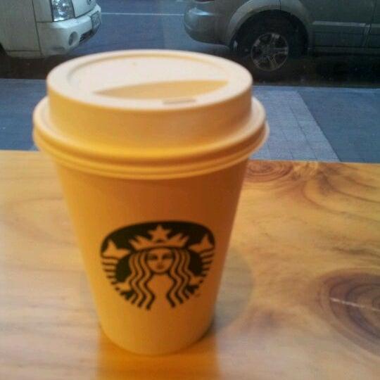 Photo taken at Starbucks by Seunghee O. on 2/14/2012