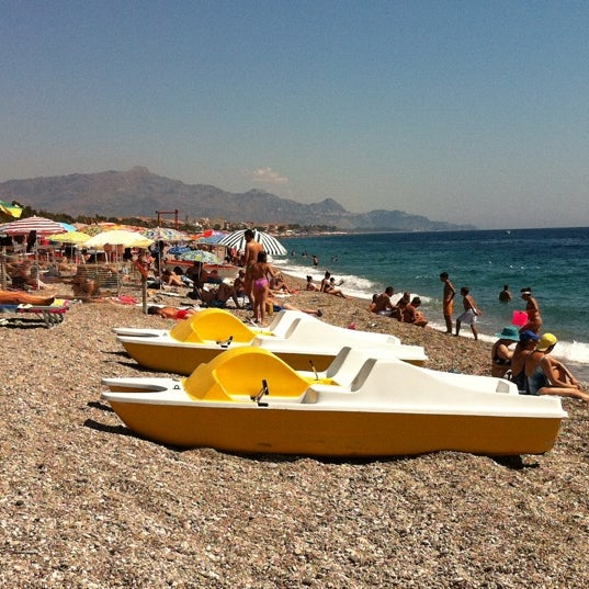 Photo taken at Spiaggia Di Fondachello by Simone L. on 8/17/2011