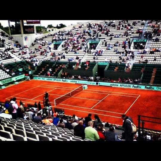 Photo taken at Stade Roland Garros by Deepa P. on 6/5/2012