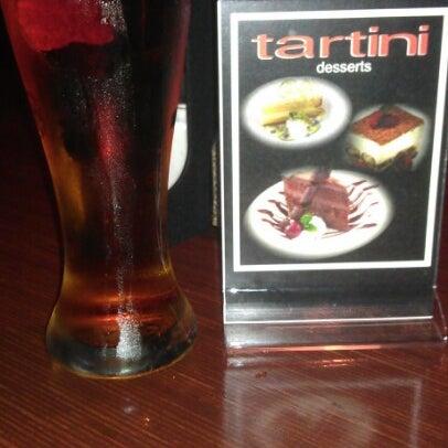 Photo taken at Tartini Pizzeria & Spaghetteria by Rob L. on 12/15/2012