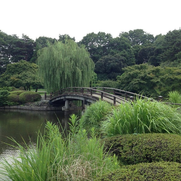 Photo taken at Shinjuku Gyoen by Jay S. on 7/27/2013