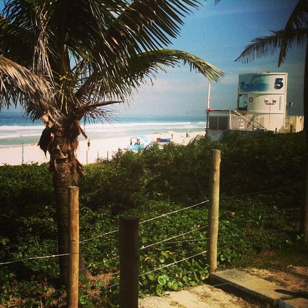 Photo taken at Praia da Barra da Tijuca by Flavio F. on 6/26/2013