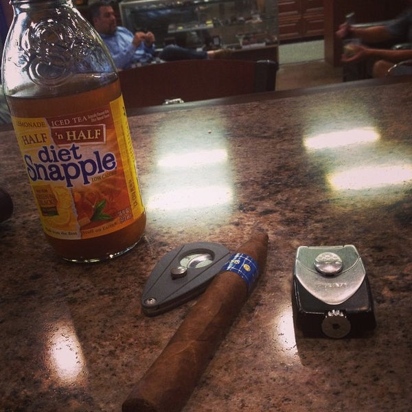 Photo taken at Smoky's Tobacco and Cigars by Ben B. on 10/2/2014