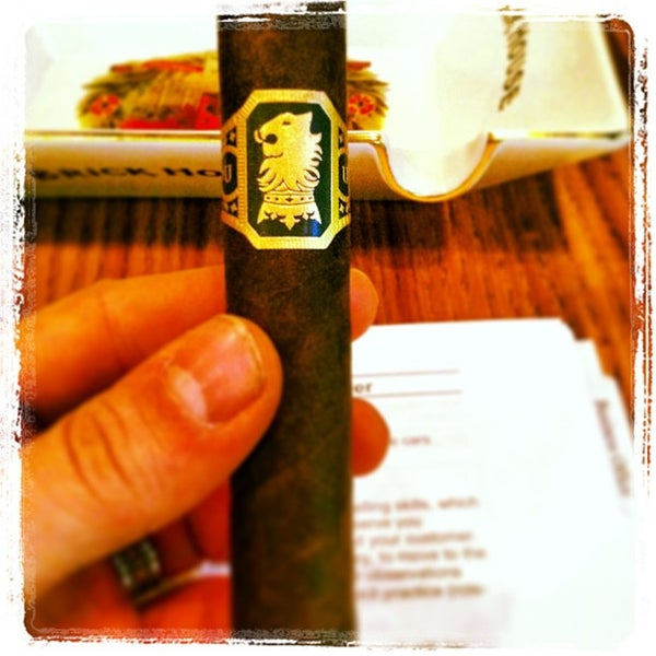 Photo taken at Smoky's Tobacco and Cigars by Ben B. on 2/13/2013