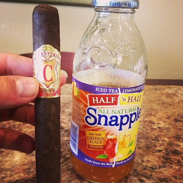 Photo taken at Smoky's Tobacco and Cigars by Ben B. on 3/12/2014