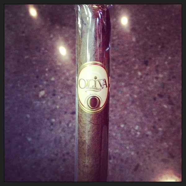 Photo taken at Smoky's Tobacco and Cigars by Ben B. on 3/15/2013