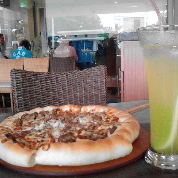 Photo taken at Pizza Hut by Dewi F. on 7/30/2014
