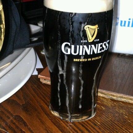 Photo taken at Fado Irish Pub & Restaurant by Andrea B. on 11/16/2012