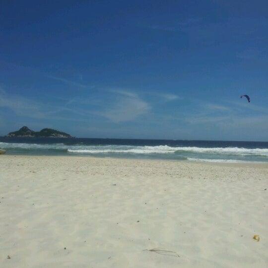 Photo taken at Praia da Barra da Tijuca by Edmar A. on 11/30/2012