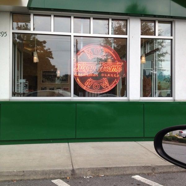 Photo taken at Krispy Kreme Doughnuts by A.D. W. on 7/1/2013