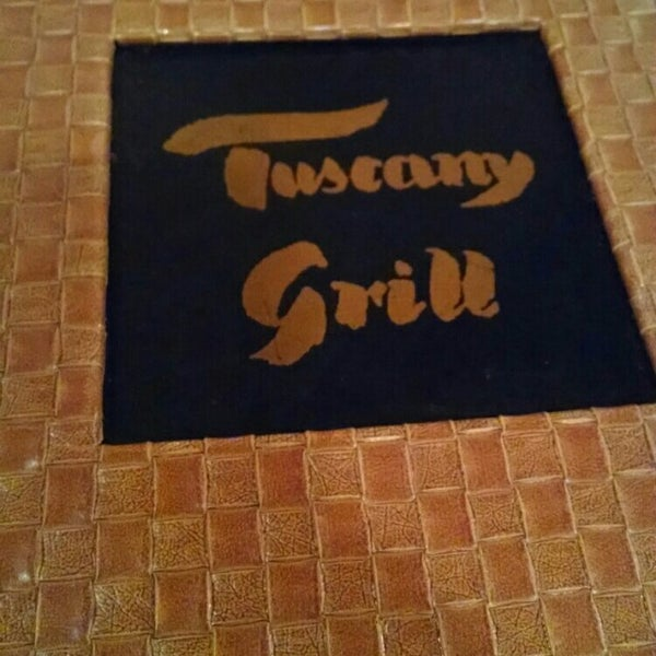 Photo taken at Tuscany Grill by Chris M. on 1/11/2015