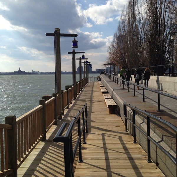 Photo taken at Battery Park City Esplanade by Dilek K. on 3/20/2014