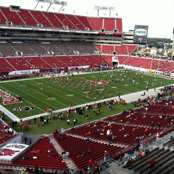 Photo taken at Raymond James Stadium by Paul B. on 12/23/2012