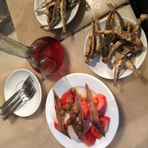 Delicious tapas! Fried anchovies, tomato onion salad, sausage on toast. Yum
