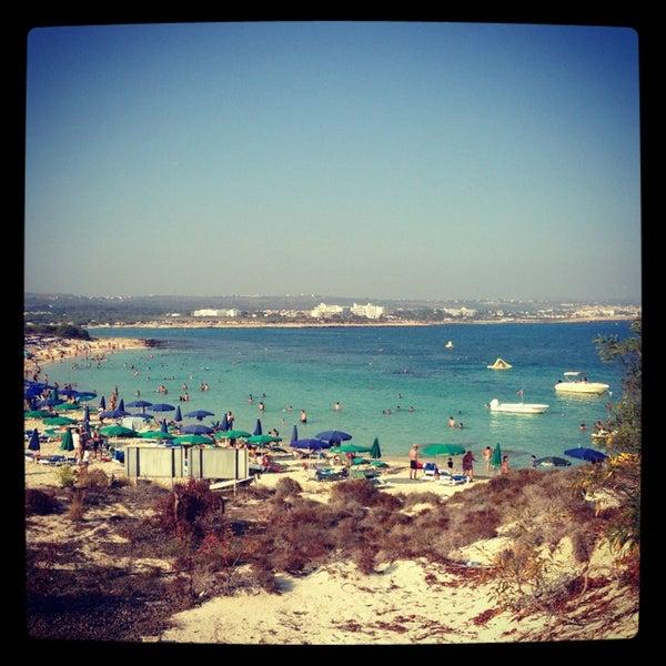 Photo taken at Makronissos Beach by Elena O. on 7/15/2013