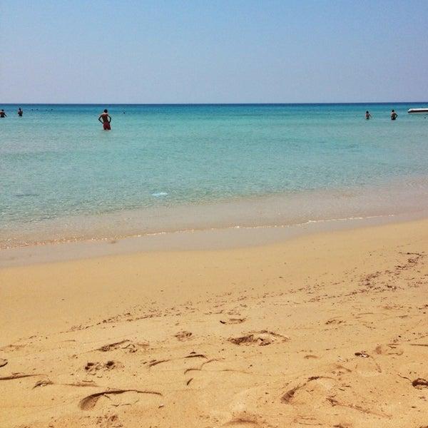 Photo taken at Ramo Beach by Erhan M. on 7/10/2013