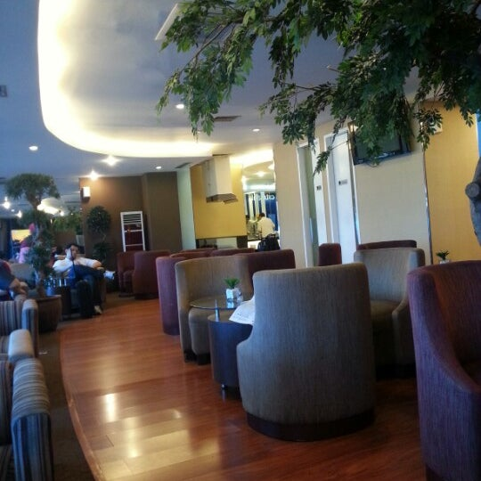 After you passed immigration desk, see your right side, you will notice blue neon box written Citibank Lounge