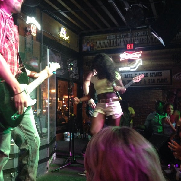 Photo taken at Honky Tonk Central by Amy F. on 6/15/2014