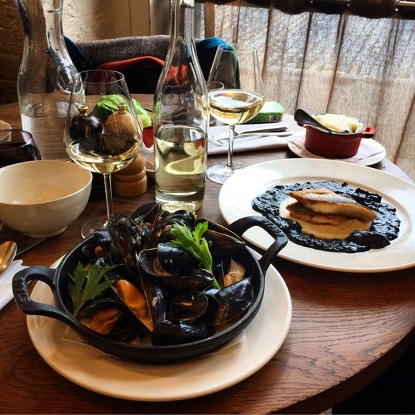 Not very expensive place, where the atmosphere and friendly staff give you such a charming feeling to comeback, the food is literally mouthwatering: Mussels in cider and Sea Bass in squid's ink & mash