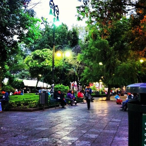 Photo taken at Jardín Hidalgo by Carla T. on 6/21/2013