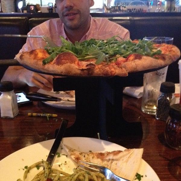 Photo taken at Tartini Pizzeria & Spaghetteria by Claudette C. on 2/1/2014