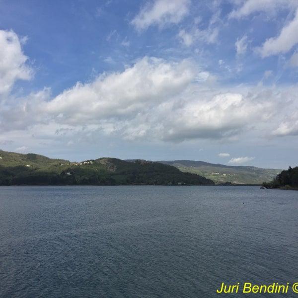 Photo taken at Lago di Suviana by Juri B. on 4/17/2016