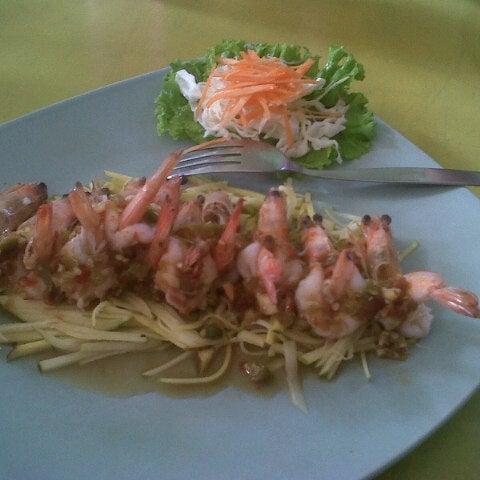 Photo taken at Phuket Thai Resto by Lina M. on 2/25/2013
