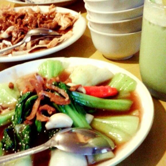 Photo taken at Phuket Thai Resto by Debin D. on 7/14/2013