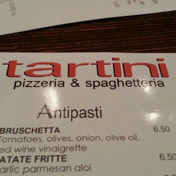 Photo taken at Tartini Pizzeria & Spaghetteria by Carolina M. on 2/22/2013