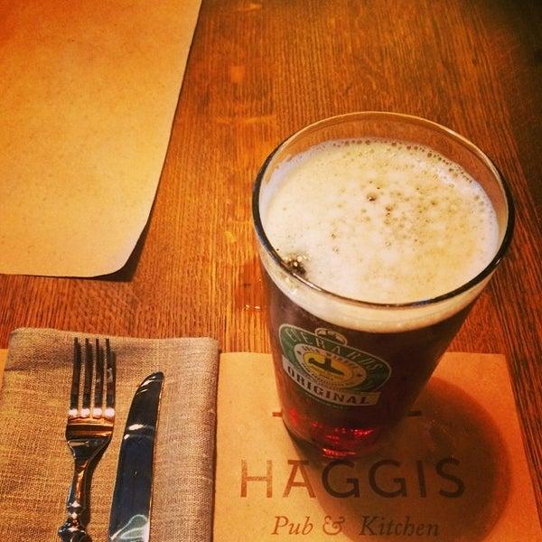 Photo taken at Haggis Pub & Kitchen by Igor P. on 6/28/2014