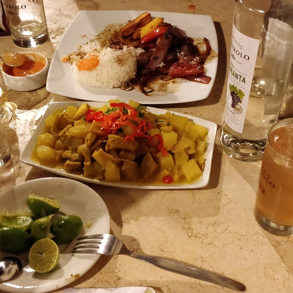 """The """"res"""" the traditional bottle of pisco with so many adds to prepare a delicious concoption called  chilcano They included long time almost disappeared """"guinda"""" drink on the side also.  Try  cau cau"""