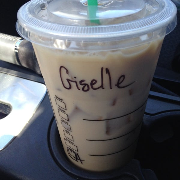 Photo taken at Starbucks by Giselle M. on 10/31/2013