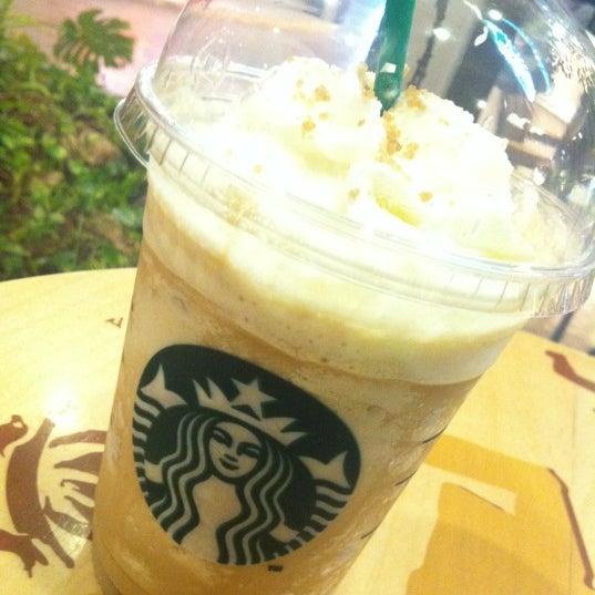 Photo taken at Starbucks by Yuttapong K. on 12/1/2012