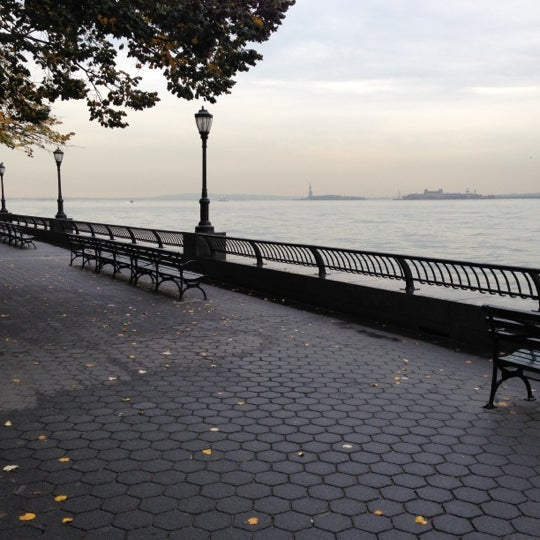Photo taken at Battery Park City Esplanade by Katie P. on 10/23/2012