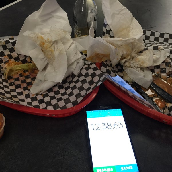 I get 2 double burgers. That's 2 lbs of protein. Think you got what it takes to beat my time? Ask John what my latest time is and beat it for your picture on the wall. My last time was 12min 38sec.