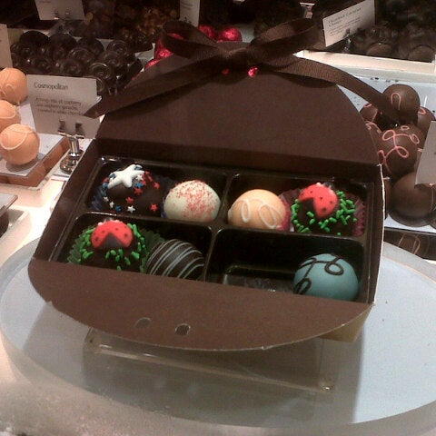 Photo taken at Godiva Chocolatier by Gemma J. on 7/1/2013